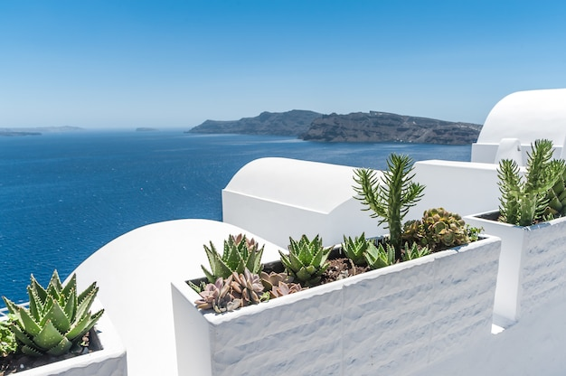 View of the volcano of santorini from the oia village Premium Photo