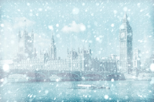 View of westminster bridge and house of parliament with snow Premium Photo