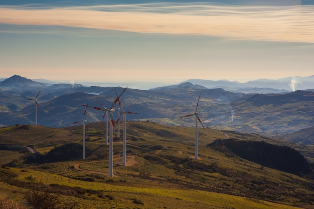 View of windmills in the sicilian countryside Premium Photo