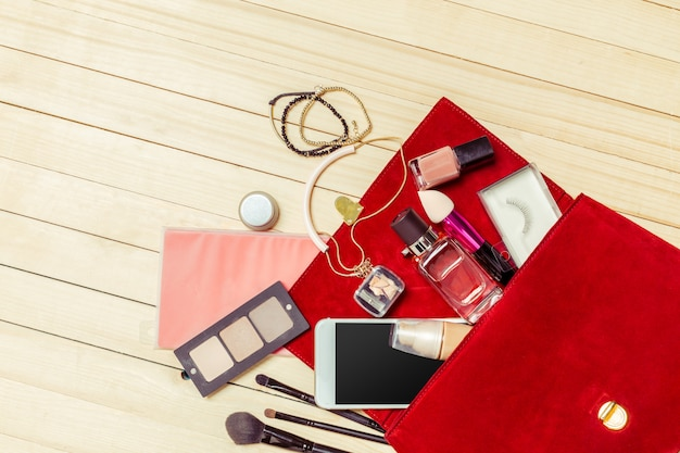 View on women bag stuff on wooden Premium Photo