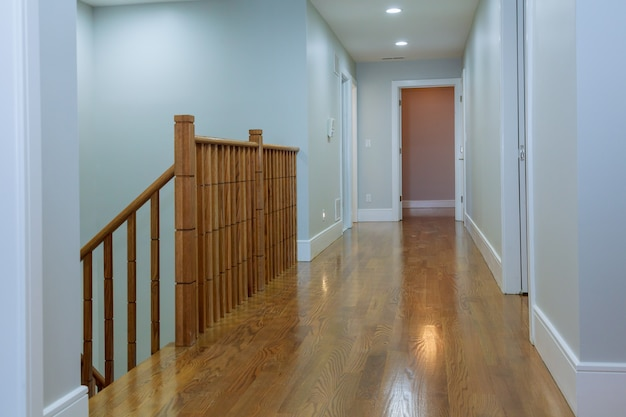View of wooden glossy stairs from upword showing a beautiful scenery hunged Premium Photo