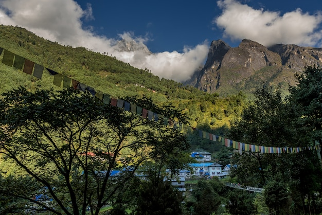 Village in mt.everest trekking route with beautiful view of mountain and river Premium Photo