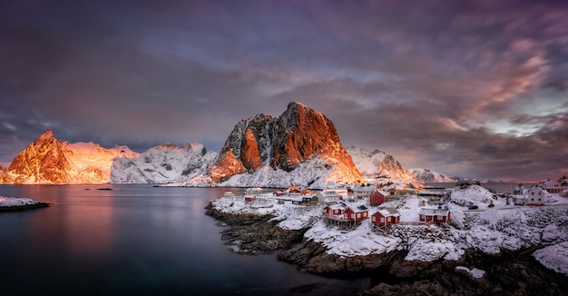 Village with snow and mountains in the arctic, lofoten islands in norway, scandinavia Premium Photo