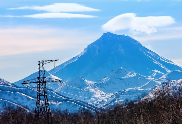 The vilyuchinsky volcano on kamchatka and high voltage power line Premium Photo