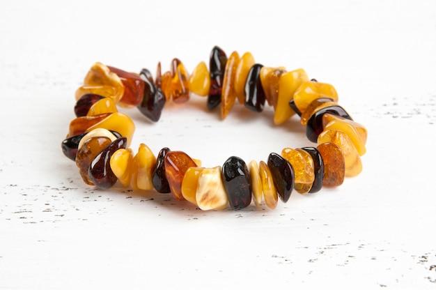 Vintage amber bracelet on white Premium Photo