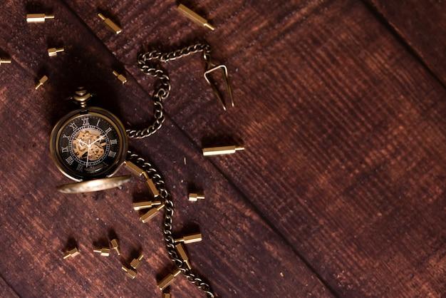 Vintage antique pocket watch on the background Premium Photo