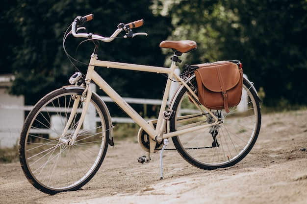Vintage bicycle alone standing on sand Free Photo