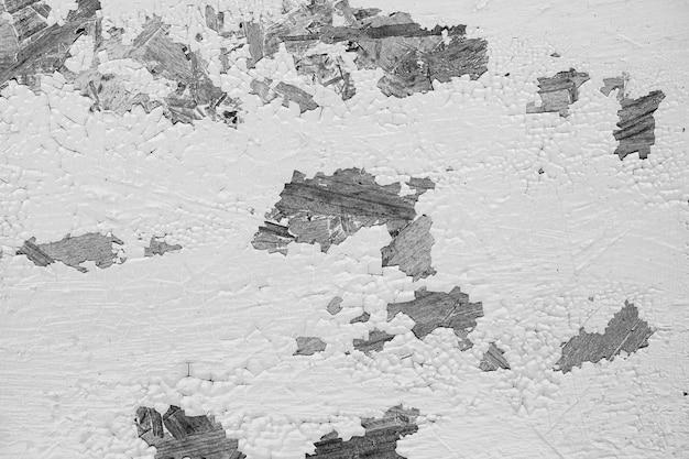 傷のあるヴィンテージの黒と白の壁 無料写真