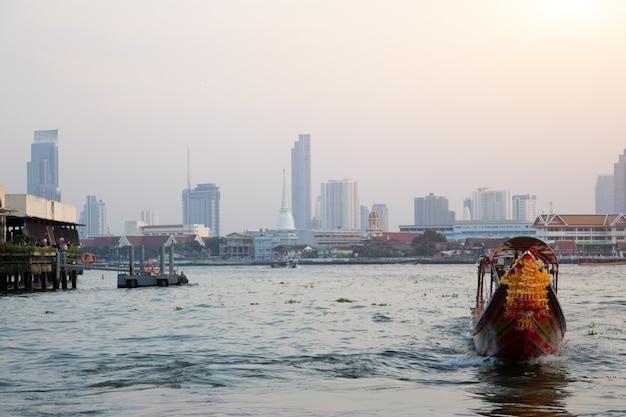 Vintage boat on water for tourism at bangkok Premium Photo