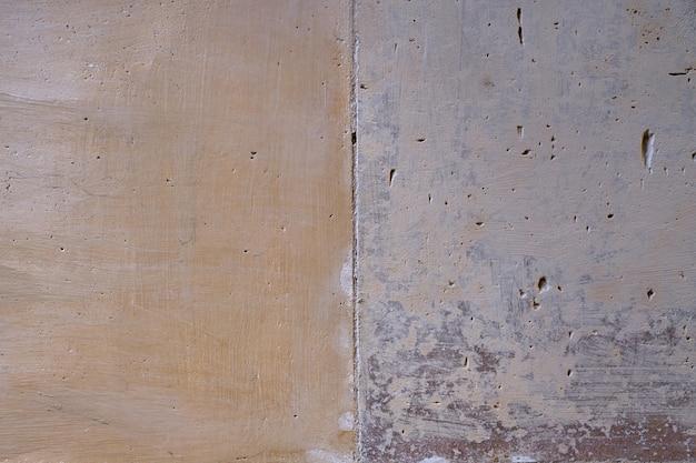 ヴィンテージのレンガを背景として壁を描いた。 Premium写真