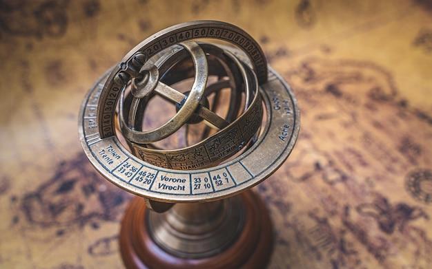 Vintage bronze armillary sundial sphere with zodiac sign Premium Photo