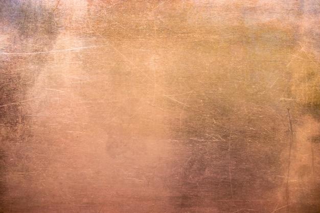 Vintage bronze or copper plate, non-ferrous metal sheet as backg Premium Photo