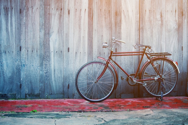 Vintage bycycle near old house at countryside in thailand Premium Photo