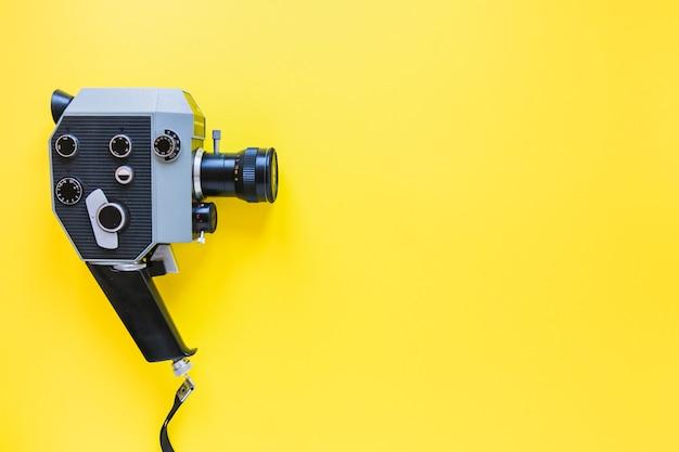 Vintage camera on yellow Free Photo