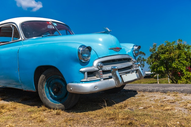 Vintage car driving in cuba Premium Photo