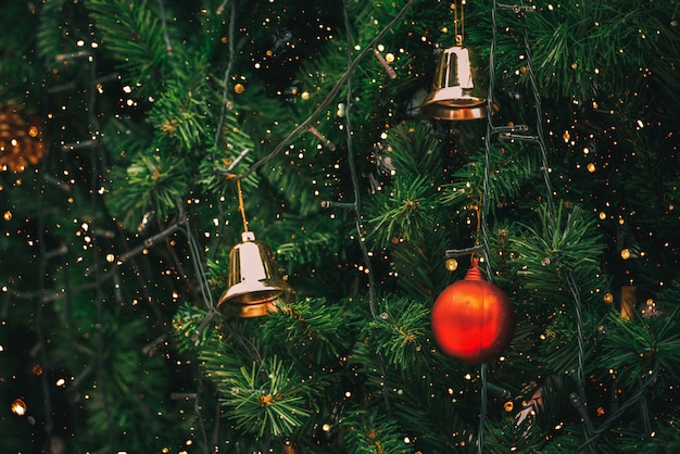 vintage christmas tree with ball decoration and sparkle light filter effect premium photo