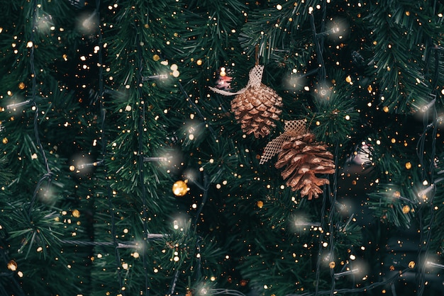 vintage christmas tree with pine cone decoration and sparkle light premium photo