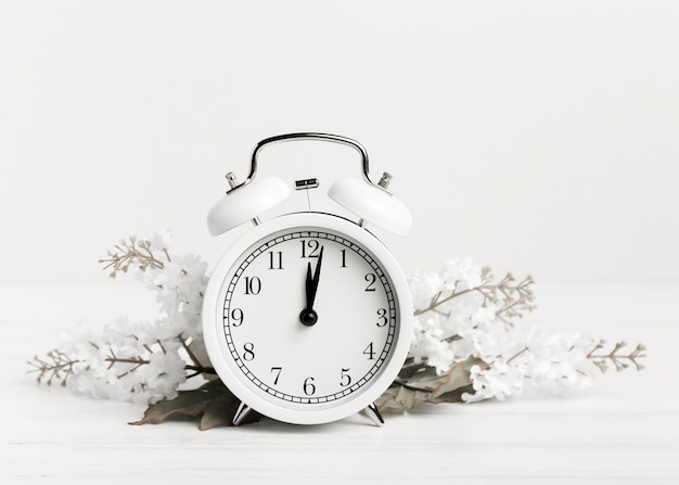 Vintage clock with white flowers Free Photo