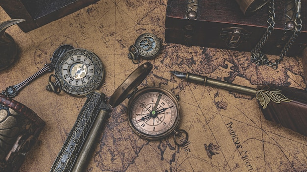 Vintage compass on old world map Premium Photo