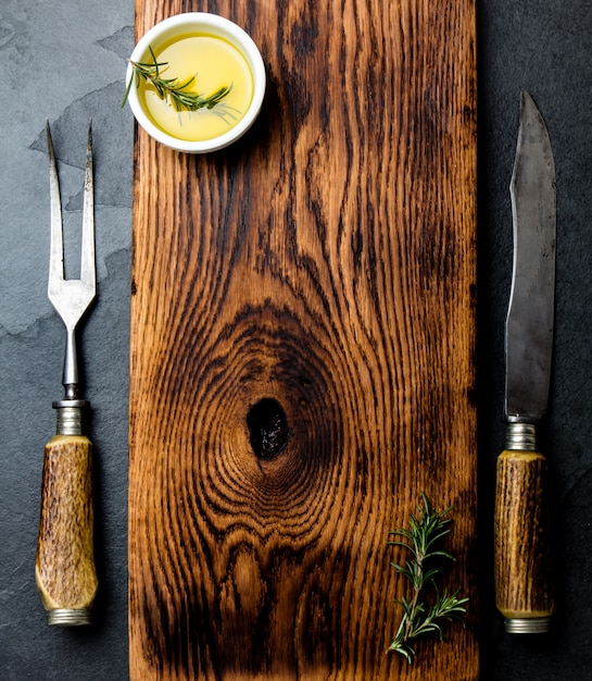 Vintage cutting board with cutlery. top view Premium Photo
