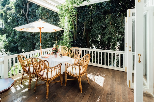 Vintage dinner table and vintage house Free Photo