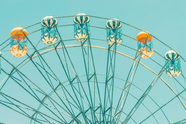 Vintage ferris wheel in the park Free Photo