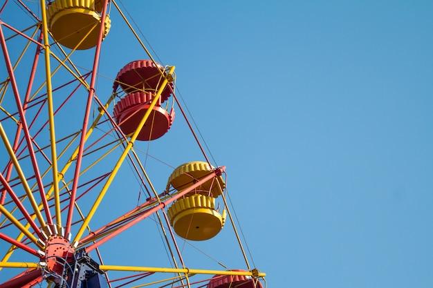 Vintage ferris wheel over turquoise sky Premium Photo