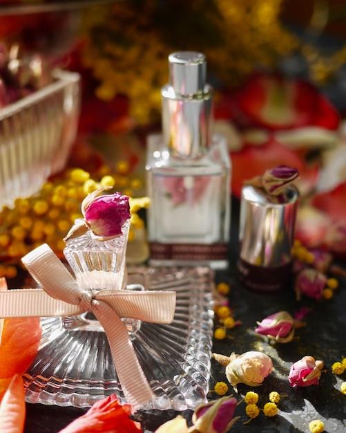 A vintage fragrant bottle with flower Premium Photo