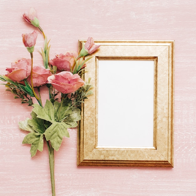 Vintage frame with pink flowers Free Photo
