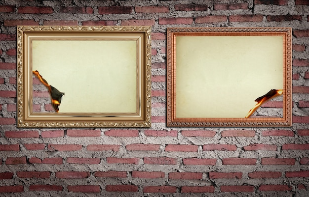 Vintage gold frame with burned on wall background Free Photo