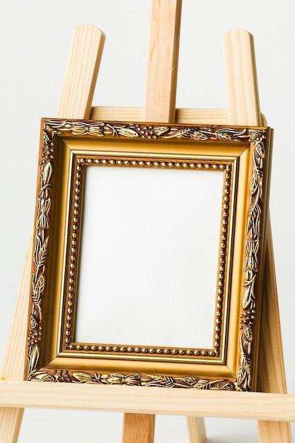 Vintage golden frame on easel Free Photo