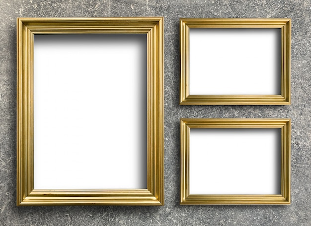 Vintage golden picture frame on rust cement wall Premium Photo