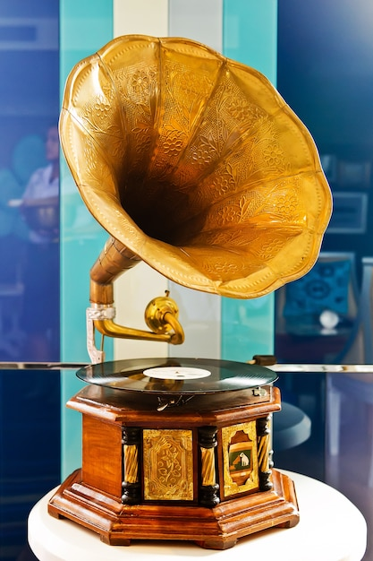 Vintage gramophone and platter on colorful background Premium Photo