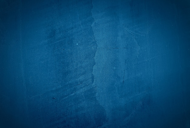 Vintage grunge blue concrete texture studio wall background with vignette. Free Photo
