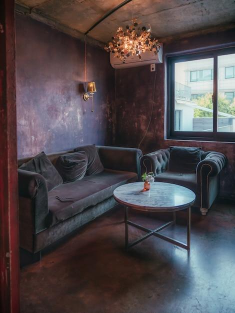 Vintage Interior With Sofa And Dark Red Walls Premium Photo