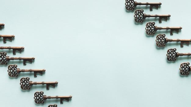 Vintage keys pattern on blue background Free Photo