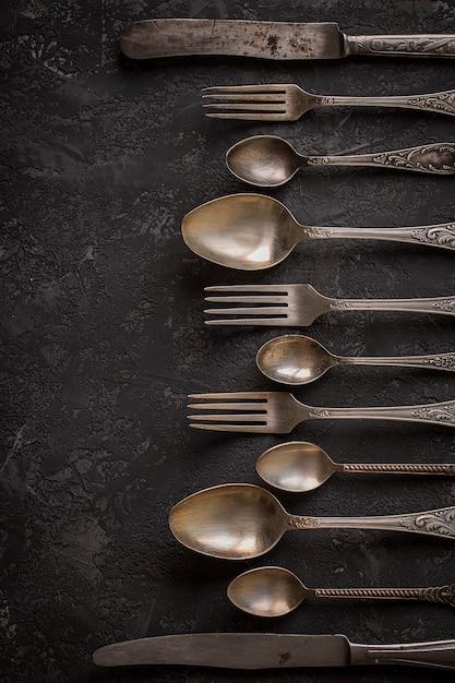 Vintage kitchen cutlery  on stone table, top view Premium Photo