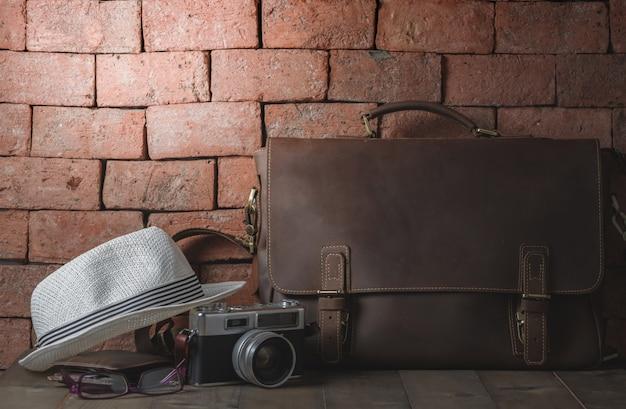 Vintage leather bag with vintage camera Premium Photo