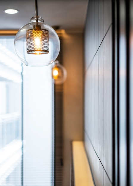 Vintage luxury interior lighting lamp cover with bronze plate and transparent glass bulb for home decor. Premium Photo