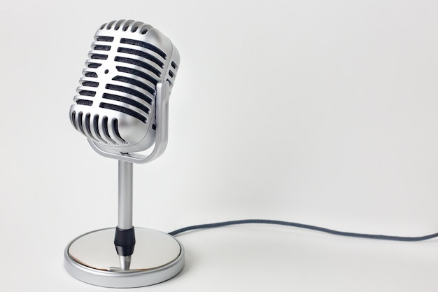 The vintage microphone close up image on white background. Premium Photo