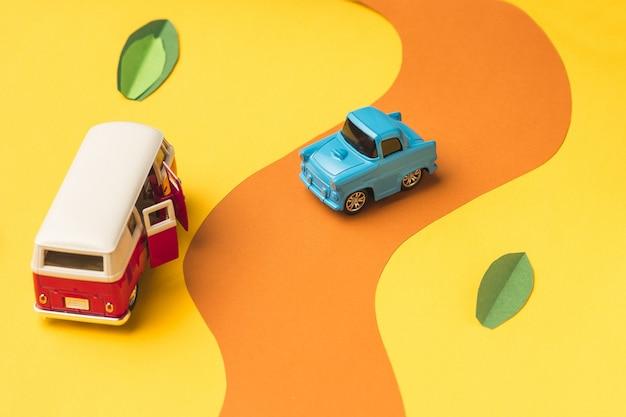 Vintage miniature car and minivan on fake road Free Photo