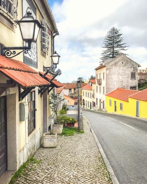 Vintage narrow street in lisbon, portugal. Premium Photo