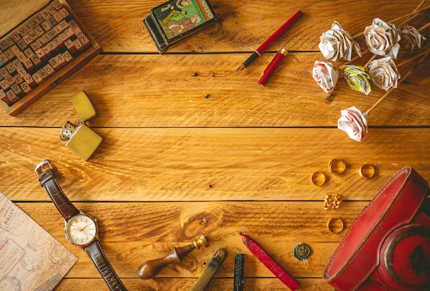 Vintage objects in a wooden table with copy space in the middle. Premium Photo