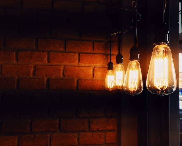 Vintage Old Lamp In Coffee Shop Cafe With Brick Wall Background Premium  Photo