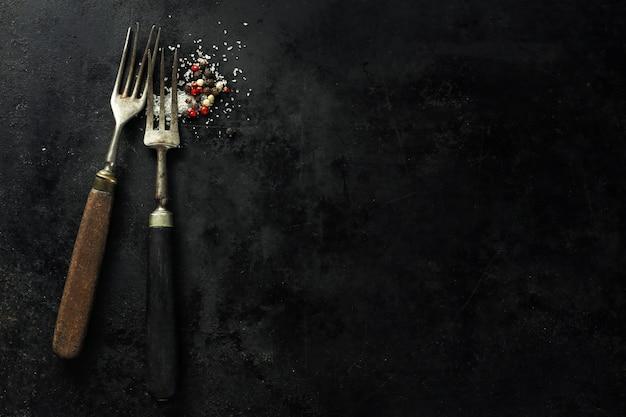 Vintage old rustic cutlery on dark Free Photo