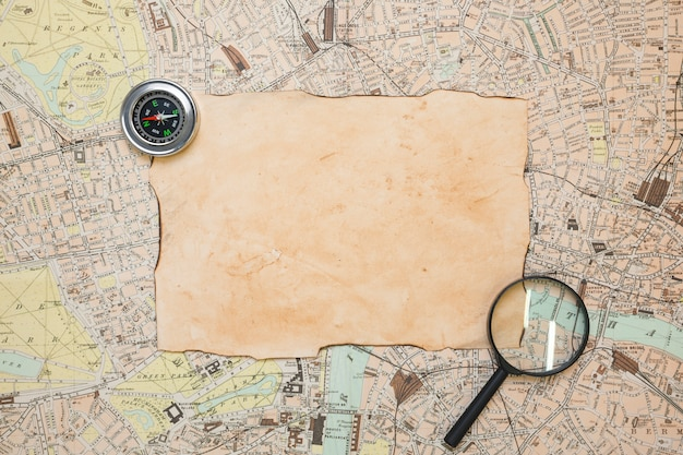 Vintage paper on map Free Photo
