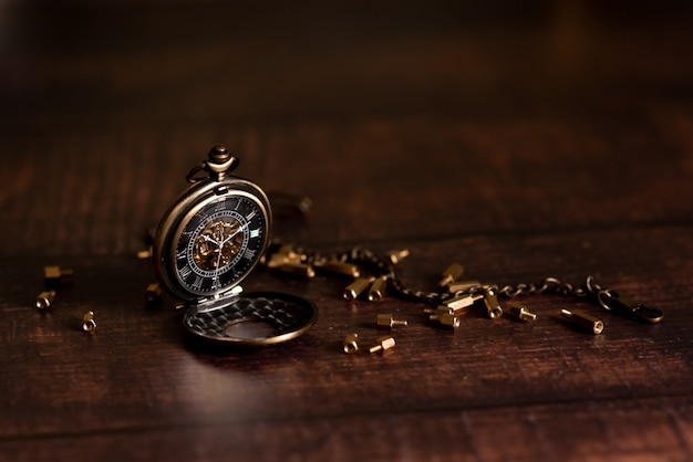 Vintage pocket watch and hour glass or sand timer, symbols of time with copy space Premium Photo