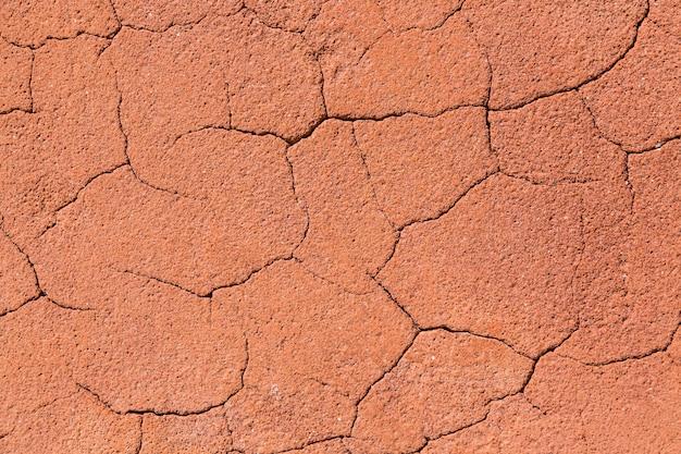 Vintage reddish cracked rock texture background Premium Photo