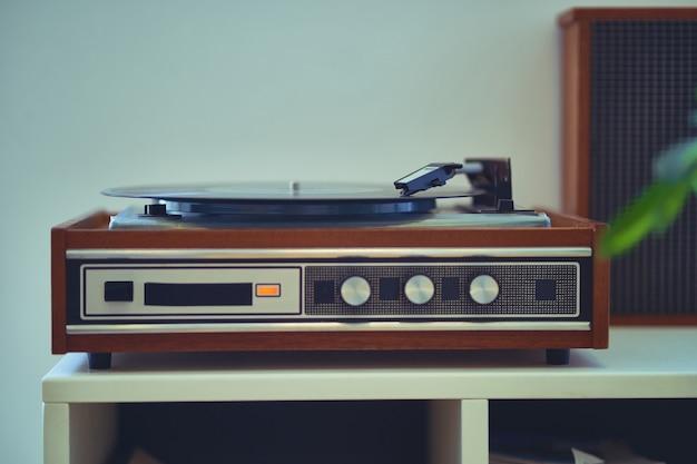 Vintage retro vinyl turntable with record Premium Photo