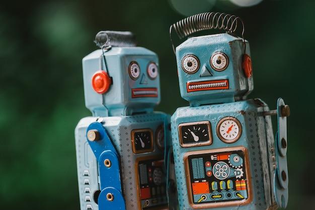 Vintage robot tin toy on yello background Premium Photo
